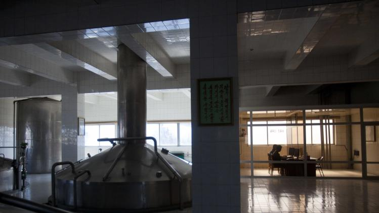 In this March 10, 2011 photo, workers at a brewery operate their section of the facility from computers in Pyongyang, North Korea. North Korea is undergoing a digital revolution of sorts, even as it holds some of the strictest cyberspace policies in the world. (AP Photo/David Guttenfelder)