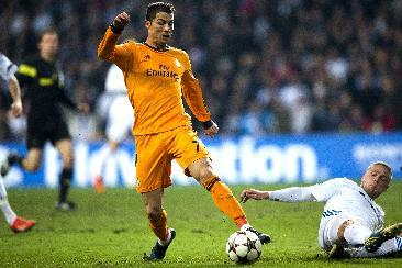 Real Madrid's Christiano Ronaldo , left wins the ball from FC Copenhagen's Ragnar Sigurdsson, during the Champions League, Group B, soccer match between FC Copenhagen and Real Madrid, at Parken in Copenhagen, Denmark, Tuesday Dec. 10, 2013