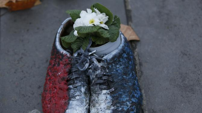 A pair of shoes are symbolically placed on the Place de la Republique, after the cancellation of a planned climate march following shootings in the French capital, ahead of the World Climate Change Conference 2015 (COP21)
