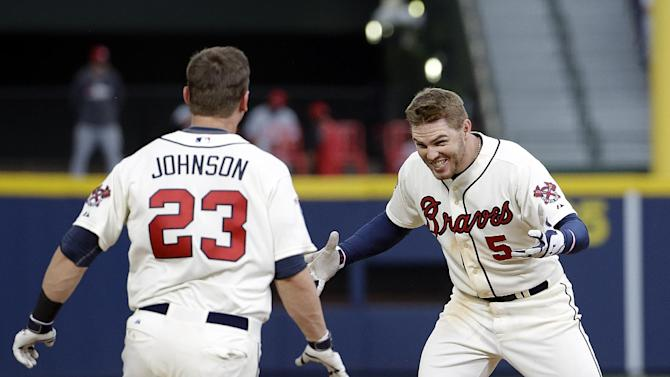 Freeman singles in 10th, Braves edge Reds 1-0