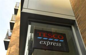 A Tesco logo is seen on a branch of the Tesco Express convenience store in central London