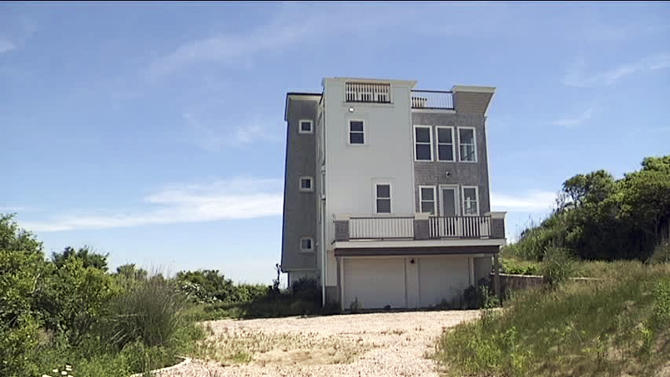 This June 16, 2014 photo shows $1.8 million waterfront house that a developer mistakenly built on park land in Narragansett, R.I., and which the Rhode Island Supreme Court has ordered it be removed. Construction began in 2009, but the developer didn't discover the error until 2011 when attempting to sell it. A foundation had been set up to preserve the property as a park in perpetuity, and the developer was told the land was not for sale. (AP Photo/WJAR-TV)