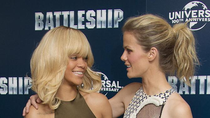 Rihanna and Brooklyn Decker, right, pose for photographers at a central London hotel during a photocall for their film 'Battleship', Wednesday, March 28, 2012. (AP Photo/Joel Ryan)