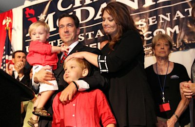 Chris McDaniel is joined by his family as he waits for the result of his GOP primary runoff election against incumbent U.S. Senator Thad Cochran on Tuesday June 24, 2014 at the Lake Terrace Convention Center in Hattiesburg, Miss. (AP Photo/George Clark)
