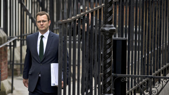 Andy Coulson, the former editor of the News of the World newspaper and former director of communications for Britain's Prime Minister David Cameron, arrives to appear at the Leveson Inquiry at the High Court in London, Thursday, May 10, 2012.  Britain's phone hacking scandal came knocking on the door of Downing Street on Thursday, as Prime Minister David Cameron's former communications chief faced a grilling by a media ethics inquiry about his time as editor of a tabloid newspaper that practiced large-scale illegal eavesdropping.  (AP Photo/Matt Dunham)