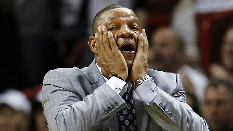 Boston Celtics head coach Doc Rivers reacts to a foul call during the first half of their NBA basketball game against the Miami Heat, Tuesday, Oct. 30, 2012, in Miami. (AP Photo/J Pat Carter)