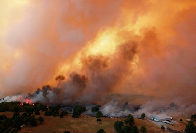 In this Saturday, Aug. 4, 2012 photo, flames burn near Highway 48 and HW 38 junction east of Drumright, Okla. The Oklahoma Department of Emergency Services says no injuries have been reported. (AP Pho
