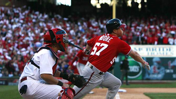 Washington Nationals' Tyler Moore (57) drives in two runs with a single against the St. Louis Cardinals in eighth-inning action during Game 1 of the National League division baseball series on Sunday, Oct. 7, 2012, at Busch Stadium in St. Louis, Mo. Cardinals catcher Yadier Molina, left, looks on. (AP Photo/The St. Louis Post-Dispatch, Chris Lee)  EDWARDSVILLE INTELLIGENCER OUT; THE ALTON TELEGRAPH OUT