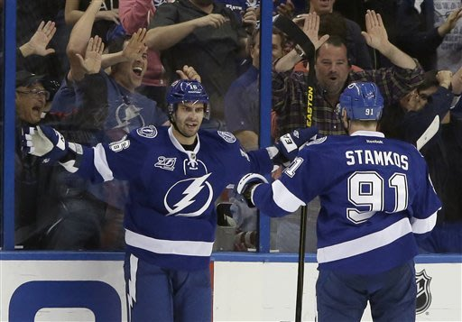 Tampa Bay Lightning right wing Teddy Purcell, left, celebrates with Steven Stamkos (91) after scoring against the Philadelphia Flyers during the first period of an NHL hockey game Sunday, Jan. 27, 2013, in Tampa, Fla. (AP Photo/Chris O'Meara)