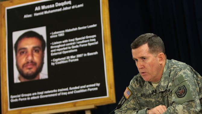 FILE - In this July 2, 2007, file photo U.S. military spokesman Brig. Gen. Kevin J. Bergner speaks during a press conference in Baghdad, Iraq, near a poster of a senior Lebanese Hezbollah operative Ali Mussa Daqduq. While the U.S. hasn't made a decision, officials said a tribunal at a U.S. military base may be the best way to deal with Daqduq, who was captured in Iraq on March 20, 2007. He has been linked to the Iranian government and a brazen raid in which four American soldiers were abducted and killed in the Iraqi holy city of Karbala in 2007.  (AP Photo/Wathiq Khuzaie, Pool, File)