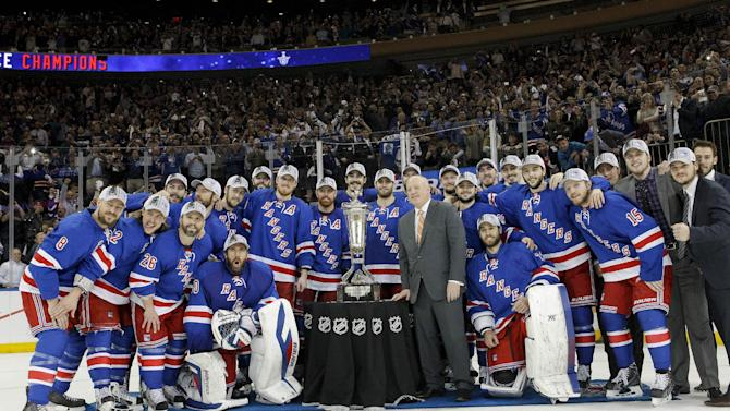 The New York Rangers pose for a photo with the Prince of Wales Cup after beating the Montreal Canadiens 1-0 in Game 6 of the NHL hockey Stanley Cup playoffs Eastern Conference finals, Thursday, May 29, 2014, in New York
