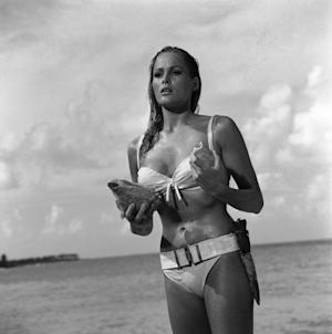 """This undated publicity photo provided by United Artists and Danjaq, LLC shows Ursula Andress in a scene from the James Bond 1962 film, """"Dr. No."""" When Ursula Andress emerged from the sea, curves glistening, with a dagger strapped to her bikini in 1962's """"Dr. No,"""" she made the Bond girl an instant icon. The film is included in the MGM and 20th Century Fox Home Entertainment Blu-Ray """"Bond 50"""" anniversary set. (AP Photo/United Artists and Danjaq, LLC)"""