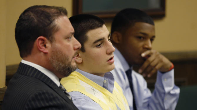 From left, Defense attorney Adam Nemann, his client, defendant Trent Mays, 17, and co-defendant 16-year-old Ma'lik Richmond listen to testimony during Mays and Richmond's trial on rape charges in juvenile court on Thursday, March 14, 2013 in Steubenville, Ohio. Mays and Richmond are accused of raping a 16-year-old West Virginia girl in August of 2012. (AP Photo/Keith Srakocic, Pool)