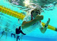 Croatia coach Ratko Rudic swims after jumping in the pool to celebrate his team's 8-6 victory over Italy during the men's water polo gold medal match at the 2012 Summer Olympics, Sunday, Aug. 12, 2012, in London. (AP Photo/Julio Cortez)