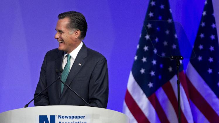 Republican presidential candidate, former Massachusetts Gov. Mitt Romney reacts to a question while speaking at the Newspapers Association of America/ American Society of News Editors luncheon gathering in Washington, Wednesday, April 4, 2012.  (AP Photo/Manuel Balce Ceneta)