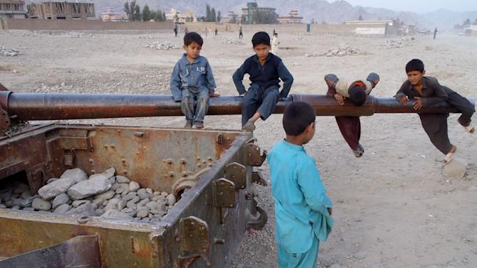 Afghan children play on the remains of a Soviet tank in the Behsood district of Jalalabad, Afghanistan, Monday, Feb 18, 2013. Despite being a mineral-rich country, four decades of war have left Afghanistan as one of the least developed countries in the world and highly dependent on foreign aid. (AP Photo/Rahmat Gul)