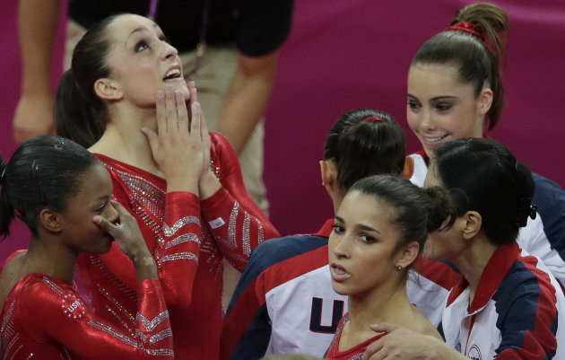 U.S. gymnasts, left to right, Gabrielle Douglas, Jordyn Wieber, Alexandra Raisman and McKayla Maroney waits for the declaration of results during the Artistic Gymnastic women&#39;s team final at the 2012 Summer Olympics, Tuesday, July 31, 2012, in London. (AP Photo/Gregory Bull)
