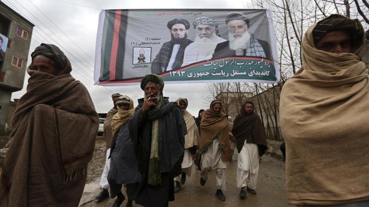 Supporters of Afghan presidential candidate Abdul Rassoul Sayyaf leave after attending his campaign in Shakar Dara district of Kabul