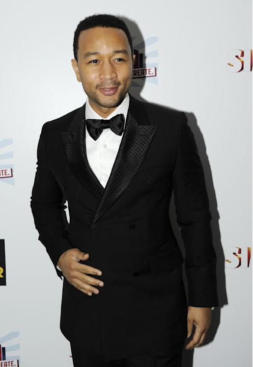 John Legend arrives at the EA SimCity Learn. Build. Create. Inauguration After-Party, Tuesday, Jan. 22, 2013, in Washington. (Photo by Nick Wass/Invision for EA/AP Images)