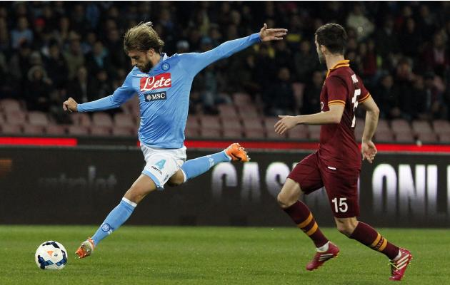 Napoli's Henrique challenges Pjanic of AS Roma during their Serie A soccer match at San Paolo stadium in Naples