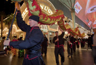 Members of the Lohan School of Shaolin parade up and down Fremont Street while doing a dragon dance during Chinese New Years festivities, Wednesday, Jan. 25, 2012, in Las Vegas. There are generally more Asian gamblers in Vegas because of the Chinese New Year, and it means increased traffic at high limit baccarat tables. Though not widely known, baccarat is actually the most profitable table game for casinos which try to court Asian gamblers who tie luck and good fortune to the start of the Lunar Year. (AP Photo/Julie Jacobson)