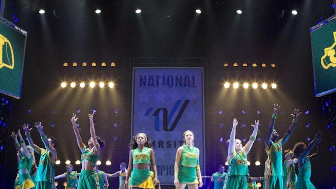 """This theater image released by The Hartman Group shows Adrienne Warren, center left, and Taylor Louderman, center right, during a performance of """"Bring It On: The Musical,"""" at the St. James Theatre in New York. (AP Photo/The Hartman Group, Joan Marcus)"""
