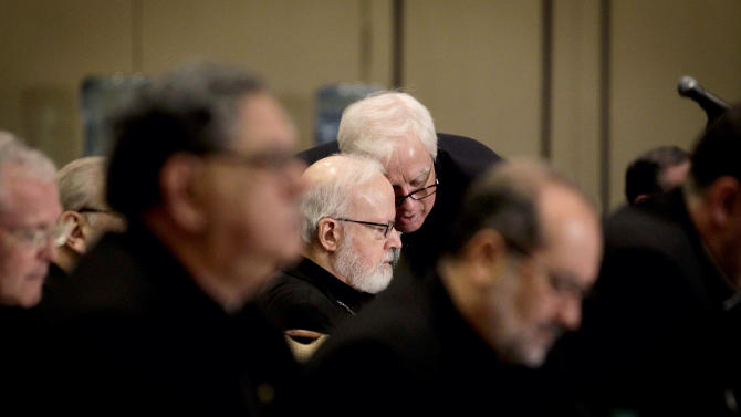 Cardinal Sean O'Malley of the Archdiocese of Boston, left, speaks with Secretary for Communications Terrence Donilon, during the U.S. Conference of Catholic Bishops' biannual meeting Wednesday, June 13, 2012, in Atlanta. The national gathering is the bishops' first since dioceses filed a dozen lawsuits against an Obama administration mandate that most employers provide health insurance covering birth control. The rule generally exempts houses of worship, but faith-affiliated hospitals, charities and schools would have to comply. (AP Photo/David Goldman)