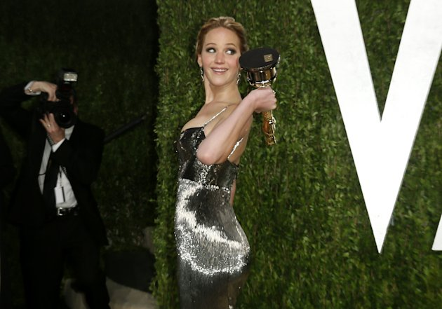Jennifer Lawrence holds her award for Best Actress for her role in