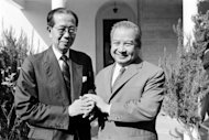 Prince Norodom Sihanouk of Cambodia (R) shakes hand with his former prime minister Son Sann on August 3, 1981 at Mougins, southern France. Cambodia's revered ex-king Sihanouk, whose life encompassed turbulent years of rule, exile and war including the Khmer Rouge reign of terror, died Monday in China, sparking nationwide mourning