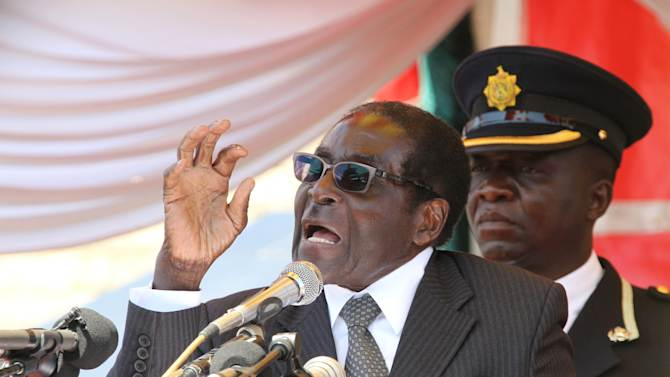 Zimbabwean President Robert Mugabe addresses mourners  at the burial of former Zimbabwean army supremo General Solomon Mujuru in Harare, Saturday, Aug, 20, 2011. Mujuru who  died  in a fire at his farm on Monday was laid to rest with full military honours.Mugabe in his speech at the burial called on called on Zimbabweans  to be peaciful and tolerant to each other  ahead of anticipated elections in the country(AP Photo/Tsvangirayi Mukwazhi)