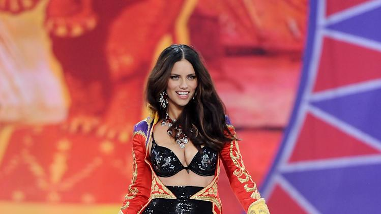 Brazilian model Adriana Lima walks on the runway during the 2012 Victoria's Secret Fashion Show on Wednesday Nov. 7, 2012 in New York. The show will be Broadcast on Tuesday, Dec. 4 (10:00 PM, ET/PT) on CBS. (Photo by Evan Agostini/Invision/AP)