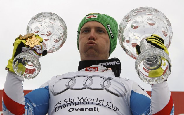 Marcel Hirscher of Austria poses with the men's overall and the Slalom World Cup trophies at the Alpine Skiing World Cup finals in Lenzerheide March 17, 2013. REUTERS/Denis Balibouse (SWITZERLAND - Tags: SPORT SKIING)