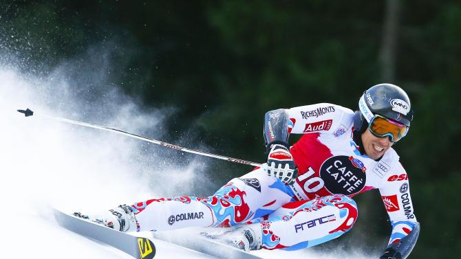 Muffat-Jeandet of France clears a gate during the men's World Cup Giant Slalom skiing race in Alta Badia