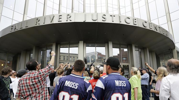 Interested bystanders and media members crowd around the entrance to the Fall River Justice Center after a bail hearing was held for former New England Patriots football player Aaron Hernandez in Fall River Superior Court Thursday, June 27, 2013 in Fall River, Mass. Hernandez, charged with murdering Odin Lloyd, a 27-year-old semi-pro football player, was denied bail. (AP Photo/Elise Amendola)