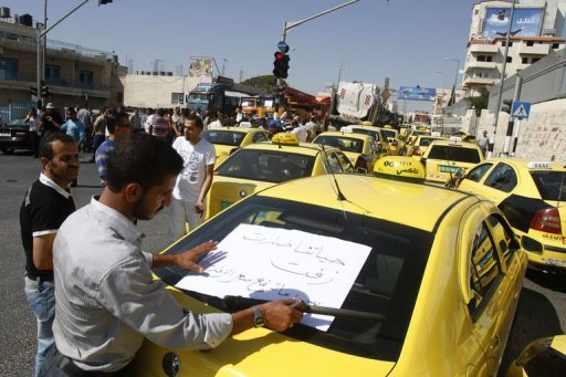 Palestinian taxi drivers park their cars in a street to protest against rising fuel prices and the high cost of living, in the West Bank city of Bethlehem. The economic outlook in the Palestinian Territories deteriorated further last year, said a UN report released Wednesday which pointed at a jobless rate of 57 percent