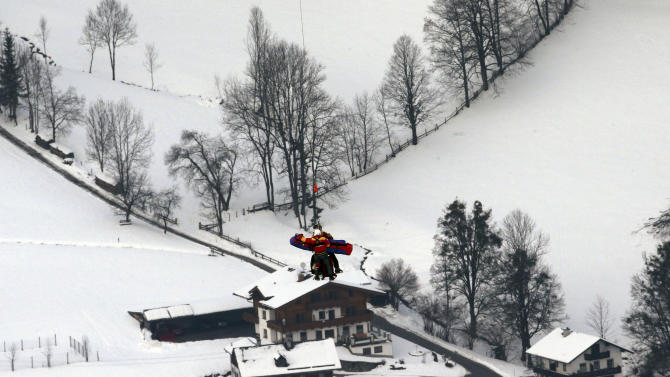 United States'LindseyVonn is airlifted after crashing during the women's super-G course, at the Alpine skiing world championships in Schladming, Austria, Tuesday, Feb.5, 2013. Vonn crashed during the super-G and has been taken by helicopter to a hospital from the world championships after apparently injuring her right knee. The American lost balance on her right leg while landing after a jump. Her ski came off immediately, and Vonn slid off course and hit a gate before coming to a standstill. Vonn received medical treatment on the slope for 12 minutes before going to the hospital. (AP Photo/Luca Bruno)