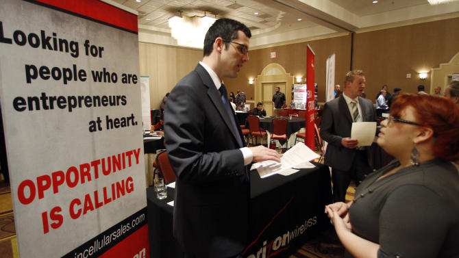 In this Oct. 4, 2011 photo, Blake Andrews with Verizon, left, visits with prospective employees during a job fair, in San Antonio. Employers advertised more jobs in September than at any other point in the past three years, a hopeful sign that job market is slowly improving. (AP Photo/Eric Gay)
