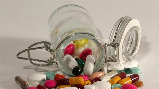 File photo illustration of pills and capsules, March 2003. REUTERS/Jacky Naegelen/Files