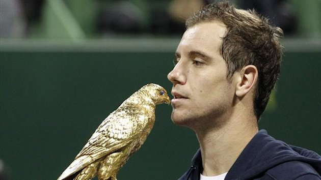 France's Richard Gasquet kisses his trophy after he won the final against Nikolay Davydenko of Russia