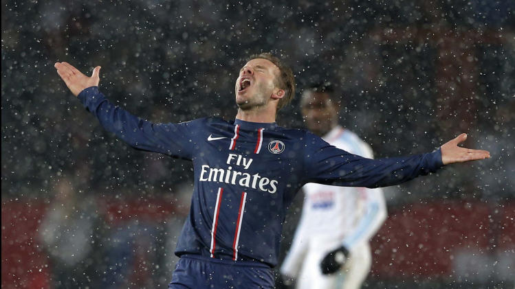 Paris Saint Germain's David Beckham reacts during their League One soccer match against  Marseille at Parc des Princes Stadium, in Paris, Sunday Feb. 24, 2013. Beckham made his Paris St Germain debut