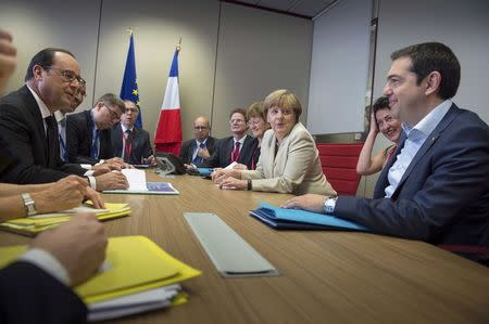 Greek Prime Minister Tsipras holds talks with German Chancellor Merkel and French President Hollande in Brussels