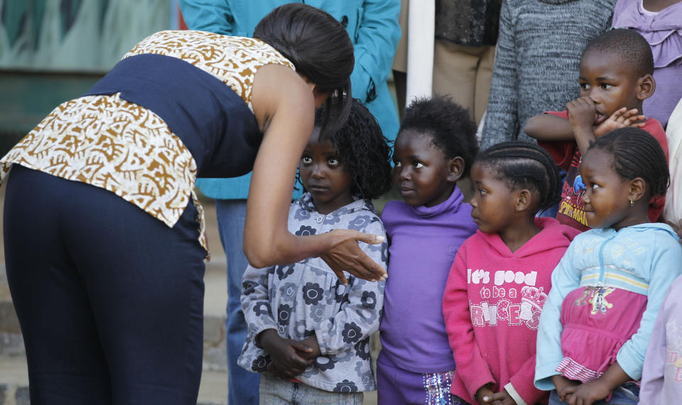 First lady Michelle Obama meets children during her visit to the Emthonjeni Community Center in Zandspruit Township, Johannesburg, South Africa, Tuesday, June 21, 2011. (AP Photo/Charles Dharapak, Pool)