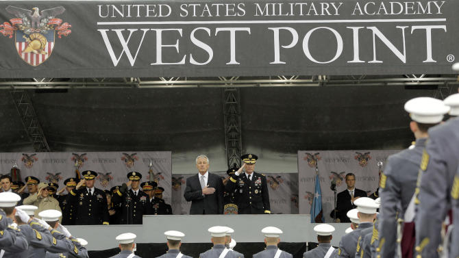 Defense Secretary Chuck Hagel, center left, and Superintendent Lt. Gen. David Huntoon, Jr., center right, stand for the national anthem during a graduation and commissioning ceremony at the U.S. Military Academy in West Point, N.Y. on Saturday, May 25, 2013. (AP Photo/Mike Groll)