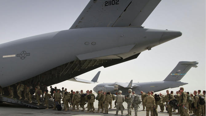 FILE - In this July 14, 2011, file photo, U.S. soldiers board a U.S. military plane, as they leave Afghanistan, at the U.S. base in Bagram north of Kabul, Afghanistan. The Obama administration gave the first explicit signal Tuesday, Jan. 8, 2013, that it might leave no troops in Afghanistan after December 2014, an option that defies the Pentagon's view that thousands of troops may be needed to keep a lid on al-Qaida and to strengthen Afghan forces.(AP Photo/Musadeq Sadeq, File)