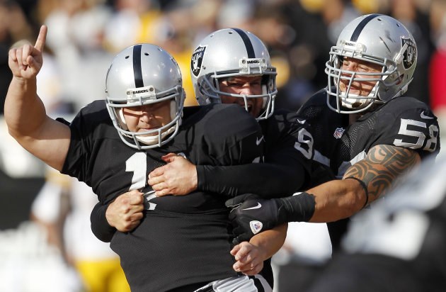 Oakland Raiders kicker Sebastian Janikowski (11) celebrates with holder Shane Lechler (9) and Dave Tollefson (58) after Janikowski&#39;s 43-yard field goal to win the game against the Pittsburgh Steelers during the fourth quarter of an NFL football game in Oakland, Calif., Sunday, Sept. 23, 2012. The Raiders won 34-31. (AP Photo/Tony Avelar)