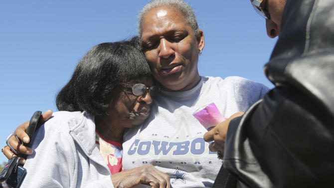 Verna Oates, right, and Flora Ford, left, comfort each other outside the the Greater Sweethome Missionary Baptist Church where a car crashed into the church in Forest Hill, Texas, Monday, Oct. 29, 2012. Forest Hill Police Chief Dan Dennis says the pastor of the church is dead after the driver of the car crashed into the building and began to assault him. Dennis said officers arrived Monday afternoon at the Greater Sweethome Missionary Baptist Church to find an assault in progress. Dennis says the suspected attacker also later died shortly after being detained.   (AP Photo/LM Otero)