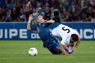 French midfielder Mathieu Valbuena (L) collides with Uruguayan midfielder Walter Gargano during a friendly match at the Oceane stadium in Le Havre, western France. The match ended in a 0-0 draw