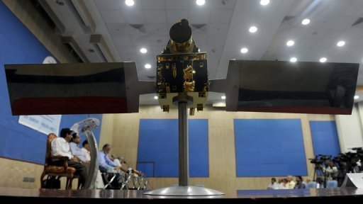 A scale model of the Megha-Tropiques satellite is seen as Indian Space Research Organisation (ISRO) officials attend a news conference in Bangalore. The Indian-French satellite that will study monsoon patterns and global warming was launched from a space centre in southern India