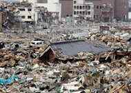 This picture taken on March 14, 2011 shows the tsunami-hit Onagawa town, in northeast Japan. Reactors at the Fukushima nuclear plant spewed radioactive contamination into the atmosphere, forcing the evacuation of tens of thousands of people