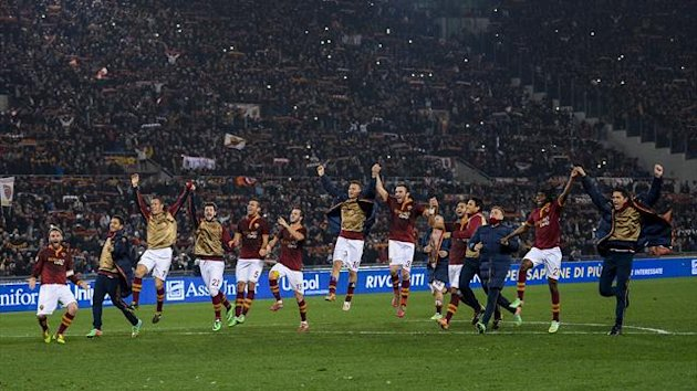 AS Roma's players and staff celebrates at the end of their quarter final Coppa Italia match against Juventus (AFP)